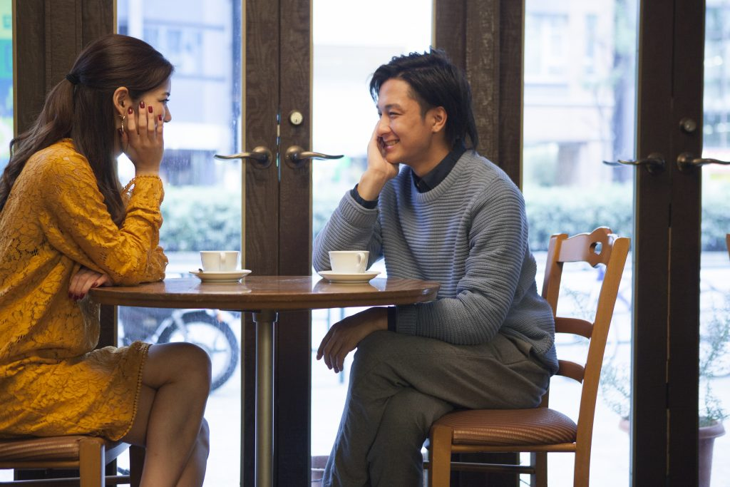 The couple have each other staring at a cafe