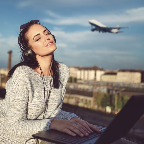 Young woman dreaming about flying