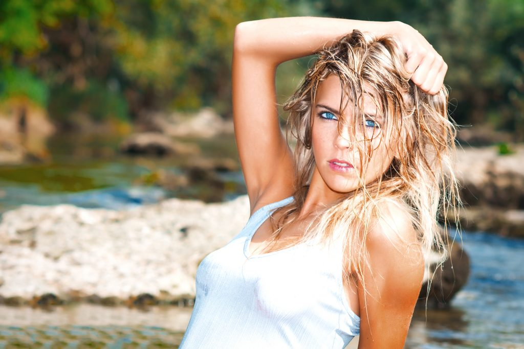 Beautiful wild wild style blonde woman with blue eyes with wet h